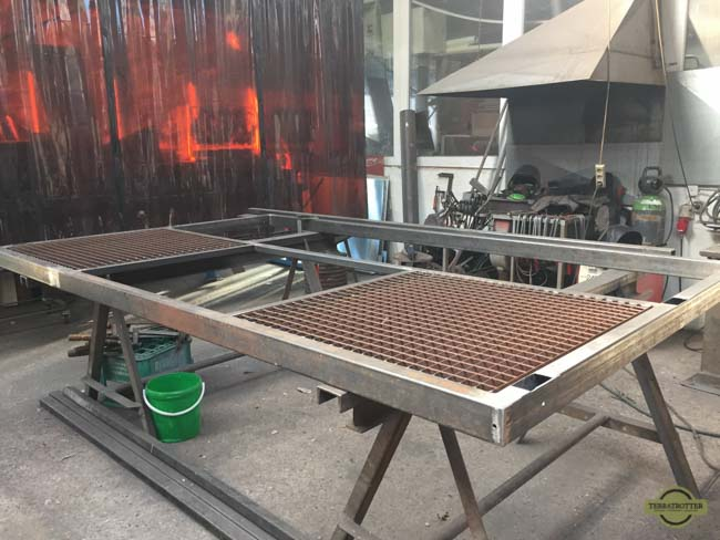 The platform laying in the workshop of the metal builder