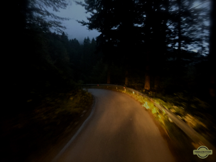 Dark mountain road in Slovenia, lidded by headlights
