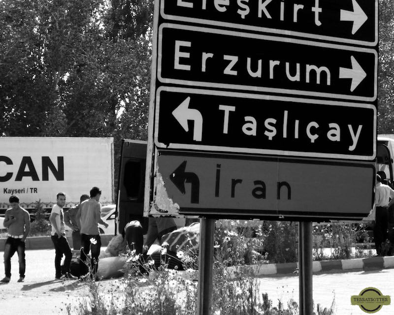 Travel destinations - Road sign with Iran