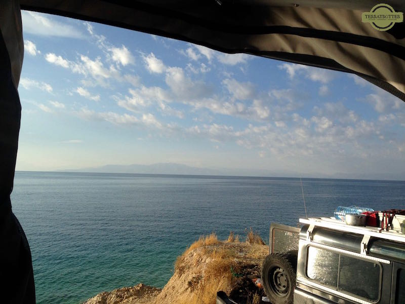 View of a lake from roof top tent