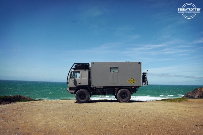 Expedition truck next to Portuguese cliff
