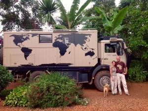 Two overland travelers and their expedition truck