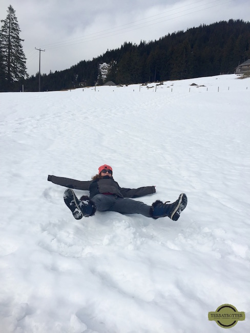 Nicole attempting to make a snow angle - Switzerland