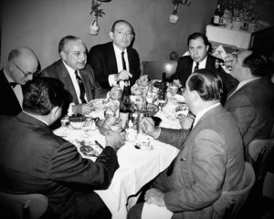 mafia man sitting around dinner table
