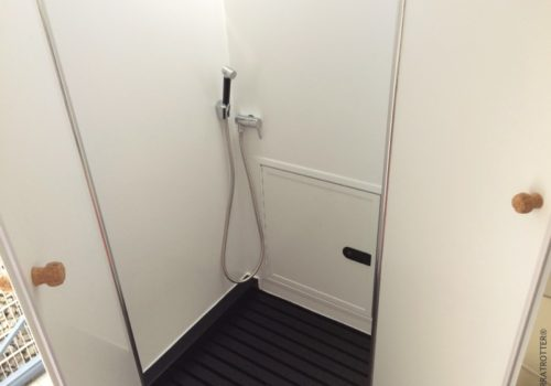 Foldaway shower in our expedition truck | Terratrotter®
